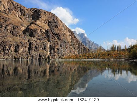 Golden Autumn Reflection Landscape Of Khalti Lake In the Tehsil Gupis of Ghizer District, Northern Pakistan