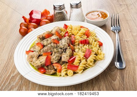 Fried Chicken Meat With Pasta And Pepper, Spices, Sauce, Fork
