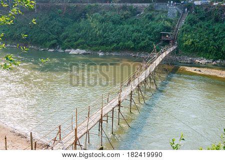 Luang Prabang, Laos - Mar 05 2015: Bamboo Bridge At Nam Khan River. A Famous Ancient City In Luang P
