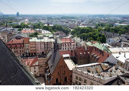 Aerial view of the Cathedral of St. Barbara and the Jesuit Monastery and other roofs of houses in the historic part of Krakow. Poland.