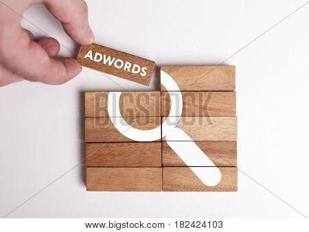 Business, Technology, Internet And Network Concept. Young Businessman Shows The Word: Adwords