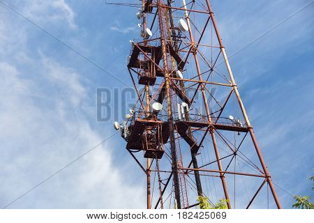 The old rusty radio tower on a blue sky background in Petropavl Kazakhstan.
