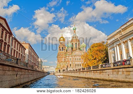 ST PETERSBURG RUSSIA -OCTOBER 3 2016. Cathedral of Our Saviour on Spilled Blood and Griboedov channel in St PetersburgRussia in sunny autumn day. Architecture landscape of St Petersburg, Russia