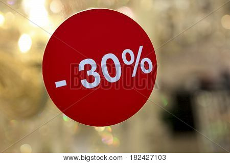 Discounted Sign On Glass Wall
