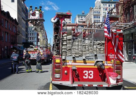 NEW YORK CITY- April 8: FDNY Training with Tower Ladder 9 on Great Jones Street, NYC. April 8, 2017.