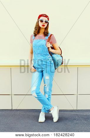 Fashion Young Pretty Woman Wearing A Denim Jumpsuit In The City Over White Background