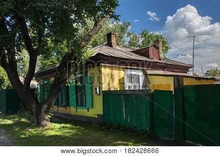 Old house in russian siberian style in the center of Petropavl Kazakhstan. The city is situated in northern Kazakhstan close to the border with Russia.