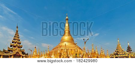 View of famous Myanmar temple and popular place to visit at Yangon city tour - pagoda Shwedagon with Buddha relics. Famous travel destination in Asia. Traditional Burmese art and culture background.