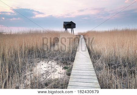 wooden path to bird observation tower on coast