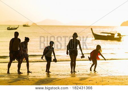 Ao Nang Krabi Thailand - March 26 2017: People on the Ao Nang beach at sunset in Krabi province Thailand