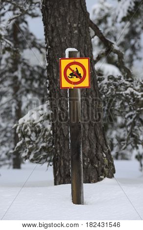 Special road sign snowmobile in arctic winter landscape.