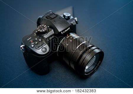 PARIS FRANCE - APR 9 2017: Modern view etail of the Panasonic Lumix DMC-GH5 - and Leica Vario-Elmarit 12-60 Micro Four Thirds System digital still and video camera with 4K 10 bit Video recording internal capability.