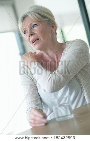Senior woman suffering arthrosis