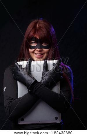 Cheerful thief in black gloves