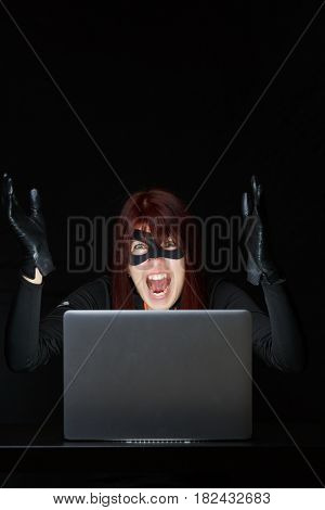 Photo of mugger with computer