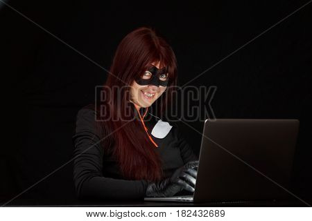Burglar in mask at night