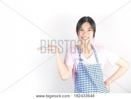Happy asian housewife maid is presenting copy space