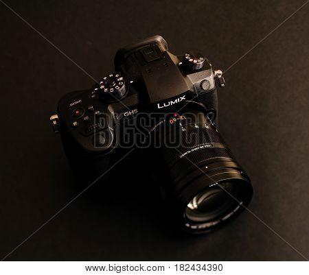 PARIS FRANCE - APR 9 2017: view detail of the Panasonic Lumix DMC-GH5 - and Leica Vario-Elmarit 12-60 Micro Four Thirds System digital still and video camera with 4K 10 bit Video recording internal capability.