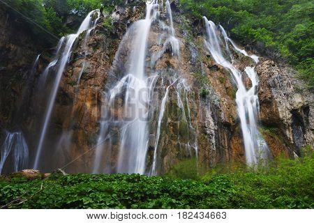beautiful waterfalls on slopes of high mountains