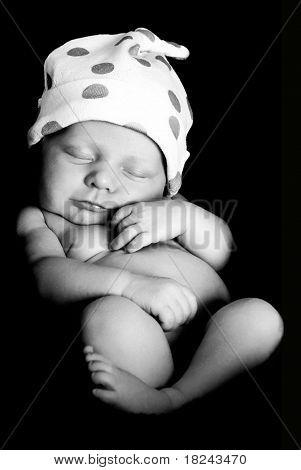 Newborn baby boy in black and white.