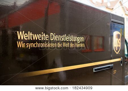 KEHL GERMANY - APR 6 2017: UPS United Parcel Service van delivery brown UPS parked on city street - rear view with German language branded inscription from UPS