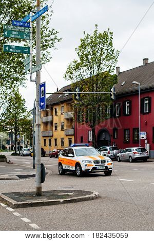 KEHL GERMANY - CIRCA 2017: German ambulance doctor arriving fast in BMW SUV at the place of the accident at the Hauptstrase in German city of Kehl - Deutsches Rotes Kreuz