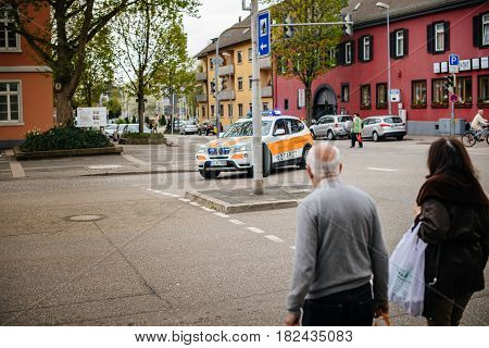KEHL GERMANY - CIRCA 2017:Pedestrians looking at ambulance doctor arriving fast in BMW SUV at the place of the accident at the Hauptstrase in German city of Kehl - Deutsches Rotes Kreuz