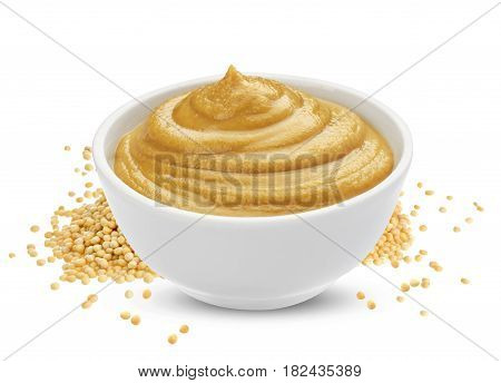 Mustard sauce in bowl and mustard seeds isolated on white background, one of the collection of various sauces