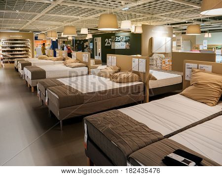 PARIS FRANCE - APR 10 2017: Customers choosing mattress and bed furniture in IKEA Shopping furniture store in Paris France. Being founded in Sweden in 1943 IKEA is the world's largest furniture retailer.