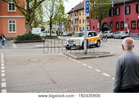 KEHL GERMANY - CIRCA 2017: Ambulance doctor arriving fast in BMW SUV at the place of the accident at the Hauptstrase in German city of Kehl - Deutsches Rotes Kreuz