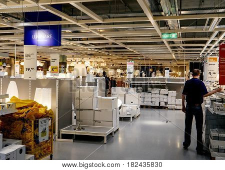PARIS FRANCE - APR 10 2017: Man buying lighting led lamps IKEA Shopping furniture store in Paris France. Being founded in Sweden in 1943 IKEA is the world's largest furniture retailer.