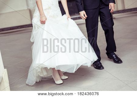 Bride with bridegroom background, Newly married couple detail on legs, Symbol of wedding background, Man with woman on wedding walk