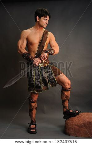 The tough sultry warrior is waiting for his lady.
