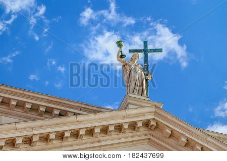 Bottom view of The statue at the San Redentore church at the isle Giudecca in Venice, Italy with blye colorful sky and white clouds