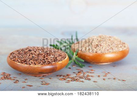 Organic linseeds and ground flaxseeds in small wooden bowls. Healthy food.