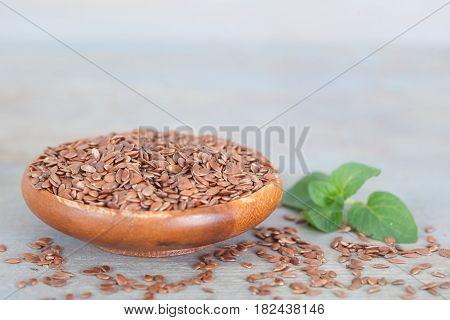 Wooden bowl full of healthy linseeds. Healthy vegan food.