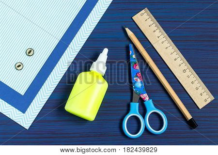 Making greeting card for Father's Day. Children's art project. DIY concept. Step-by-step photo instruction. Step 1. Preparation of materials and tools (paper buttons glue scissors pencil ruler)