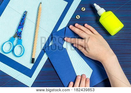 Making greeting card for Father's Day. Children's art project. DIY concept. Step-by-step photo instruction. Step 8. Child glues a tie to his shirt