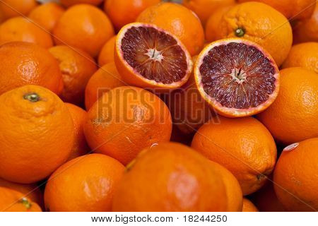 Fresh and juicy Sicilian blood oranges (Arancia Rossa di Sicilia) on display at an farmers' market stall