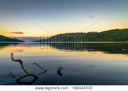 Romantic sunset on the shores of Loch Ness in Scotland