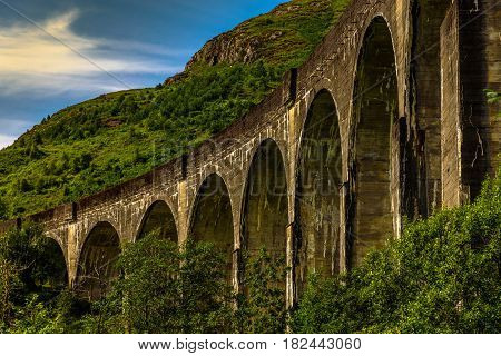 The Glenfinnan Viaduct in Scotland on a sunny day with blue Sky