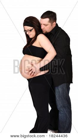 couple standing admiring woman's pregnant belly