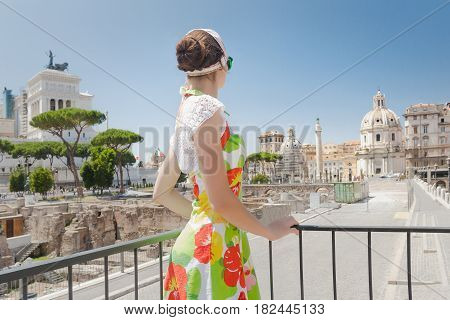 Back view of tourist girl is looking ahead on historical site