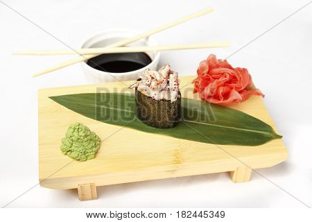 Japanese poppies with eel, salmon, flying fish roe, shrimp and ginger isolated on white background