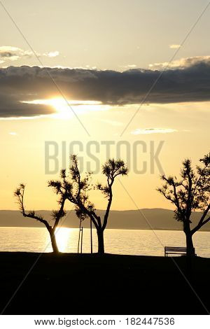 Sunset at Neusiedler lake with reflection in the water - austria