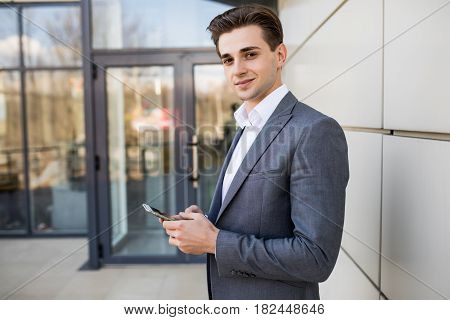 Man Texting On Phone. Casual Urban Professional Entrepreneur Using Smartphone Smiling Happy Outside