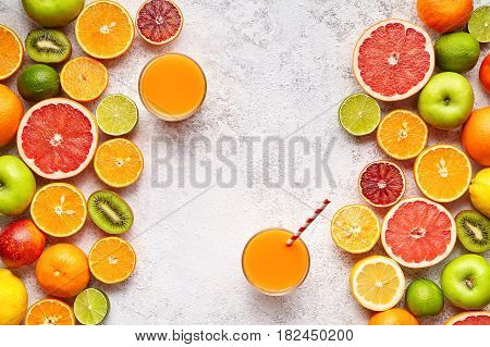 Smoothie or fresh juice vitamin drink in citrus fruits ingridient background flat lay, healthy lifestyle natural organic antioxidant detox diet beverage. Tropical summer assortment grapefruit, orange