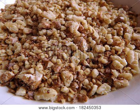 Crushed nuts , walnut , walnut background ,