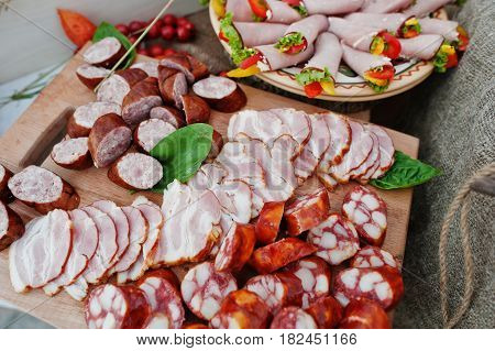 Different Sausages On Wooden Board At Catering Wedding.