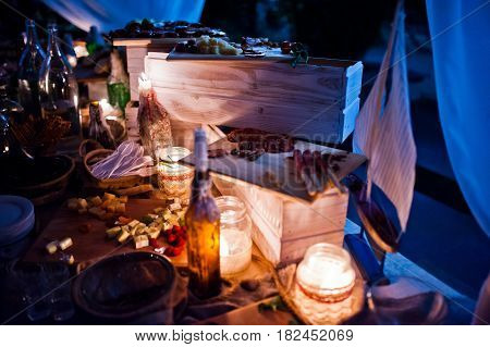 Wedding Catering Table With Different Food At Night Outdoor.